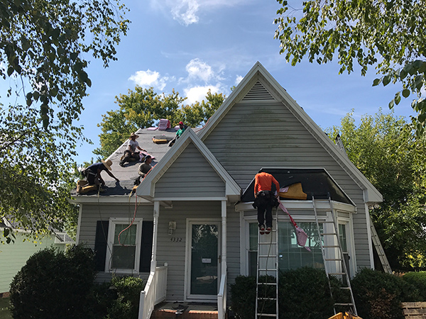 roofing contractor working on a house outside of Raleigh NC